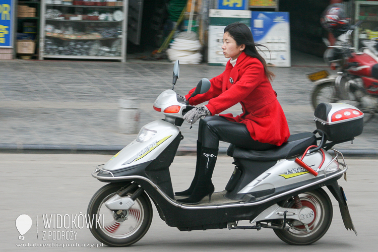 Chick on a scooter. Beijing. China.